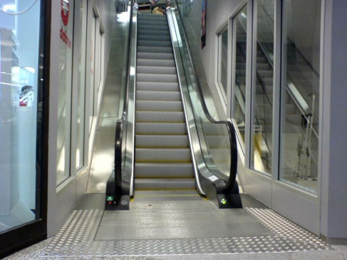 Step escalator